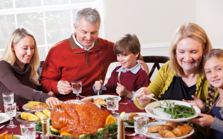 Multi-generation family enjoying holiday dinner